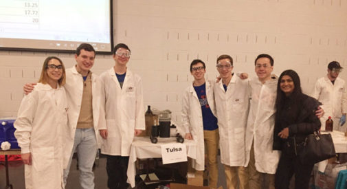 Chem-E-Car team stands at their table
